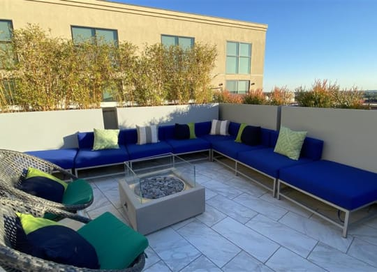 Outdoor Lounge Area With Fireplace at The Mansfield at Miracle Mile, Los Angeles, California