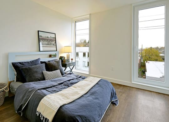 Large bedroom with 2 floor to ceiling windows. Bedroom can fit a queen or king sized bed.