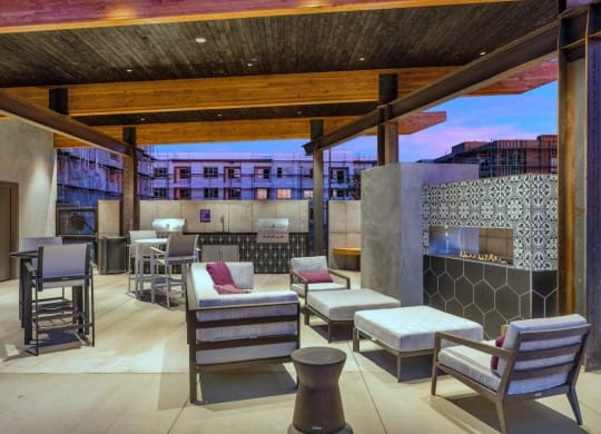 Outdoor Grill With Intimate Seating Area at The Premiere at Eastmark Apartments, Mesa, 85212