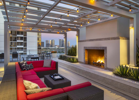 Westwood Luxury Apartments Wilshire Victoria Rooftop Resident Lounge Couch Fireplace evening dusk2