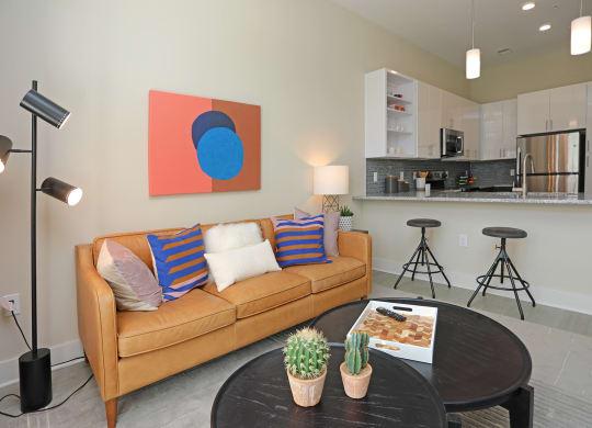 Living Room With Kitchen View at Link Apartments® Innovation Quarter, Winston Salem, North Carolina