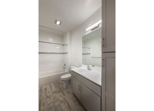 Bathroom with Vanity Lights at Apex Apartments, Arlington, 22206