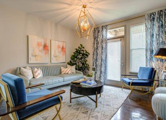 Decorated Living Room With Natural Light at River Crossing Apartments, Missouri