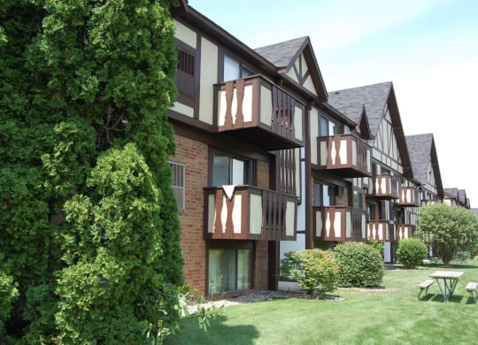 Courtyard With Mature Trees at Normandy Village Apartments, Michigan City, IN