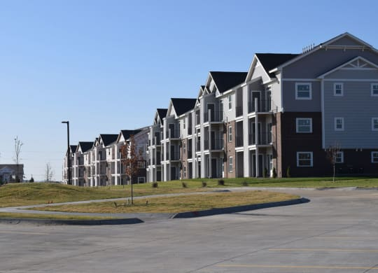 Rear Exterior Building View at Trade Winds Apartment Homes in Elkhorn, NE 68022
