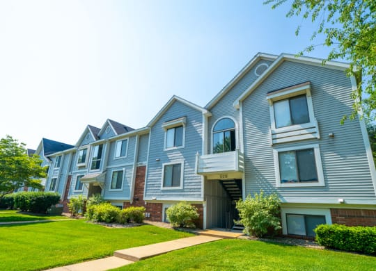 Exterior Apartment Building at Windmill Lakes Apartment Homes in Holland, MI