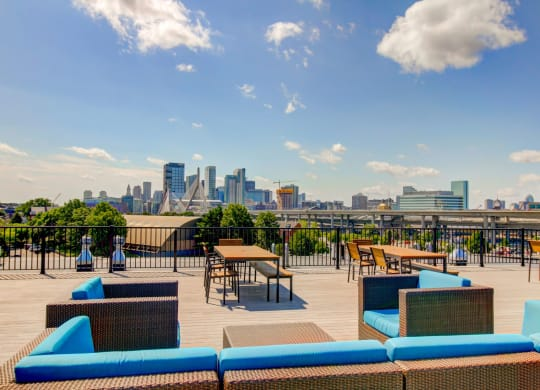 Charlestown MA Apartments with Rooftop Outdoor Living Room with  Fireside Lounge featuring fantastic views of Boston