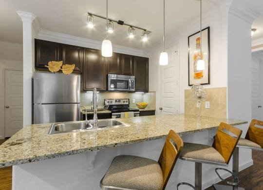 Fitted Kitchen With Island Dining at Berkshire Lakeway, Lakeway, TX, 78738