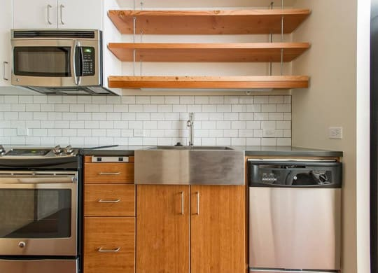 Fully Furnished Kitchen With Stainless Steel Appliances at Lower Burnside Lofts, Oregon