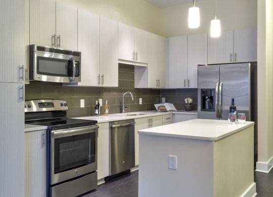 Kitchen with sleek white cabinets at Berkshire Terminus, Atlanta, Georgia