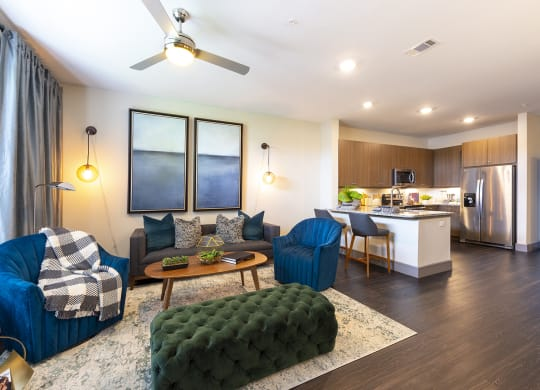 Living room with fan at Windsor Shepherd, TX, 77007