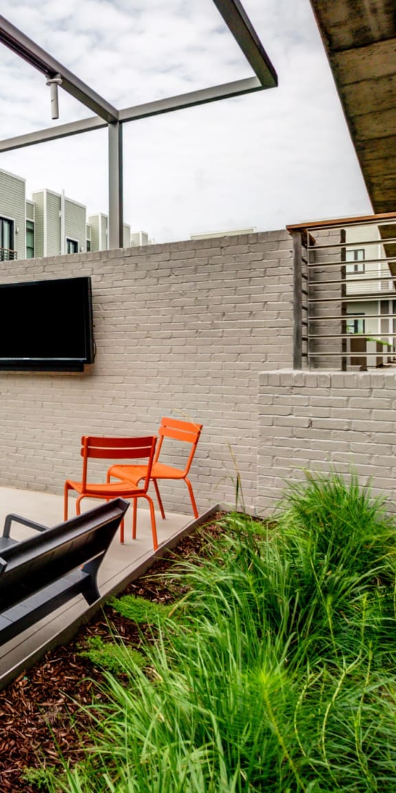 Courtyard Sitting With Shades and TV at 2100 Acklen Flats, Nashville, TN, 37212