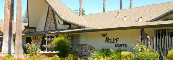 Property Sign at Reef Apartments, Fresno
