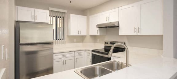 Sink With Faucet In Kitchen at Del Norte Place Apartment Homes, El Cerrito, California