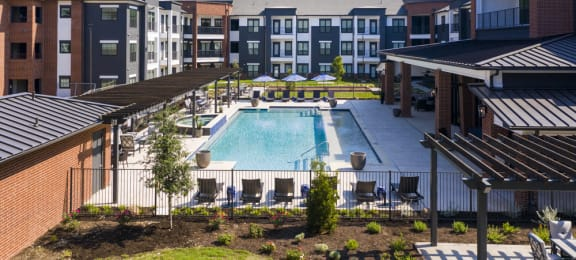 georgetown active 55+ apartments for rent with a spacious kitchen with a swimming pool