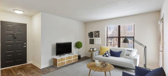 Model living room showcasing wood inspired flooring