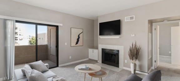 Model living room with fireplace and private patio
