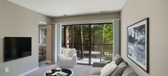 Furnished living room with large sliding patio door