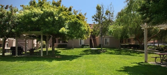 grass seating area Apartments in Corona CA -Brookwood Villas Apartments