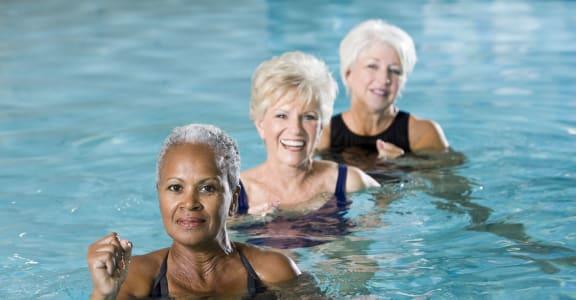 Senior Enjoying Pool at 55+ FountainGlen Terra Vista, Rancho Cucamonga, California