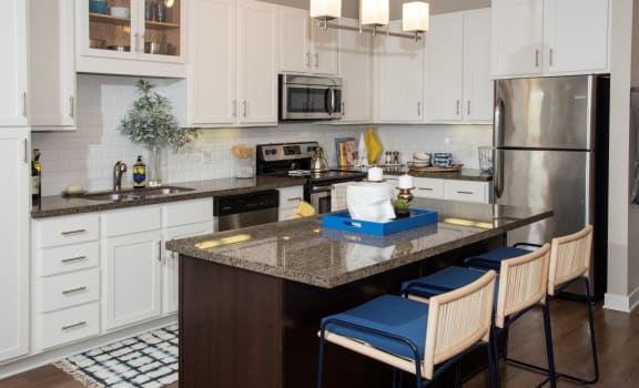 model kitchen with white cabinetry