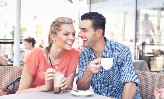 Couple having coffee Sacramento Apartments for rent l La Provence Apartments