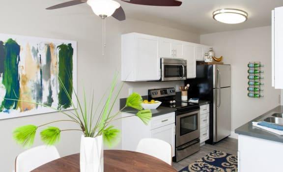 Kitchen and dining area| Stoneridge Luxury Apartments in Walnut Creek, CA