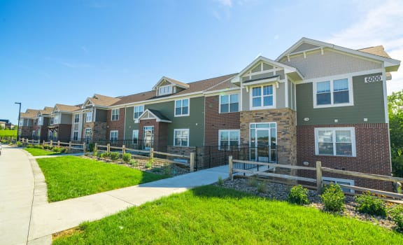 Apartment Building Exterior with Walking Paths at Strathmore Apartment Homes, Iowa