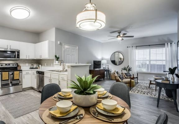 Upgraded kitchens with white cabinetry and stainless steel appliances