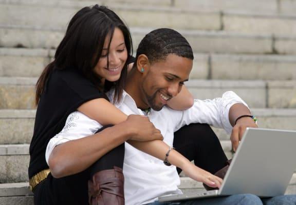 Couple browsing laptop