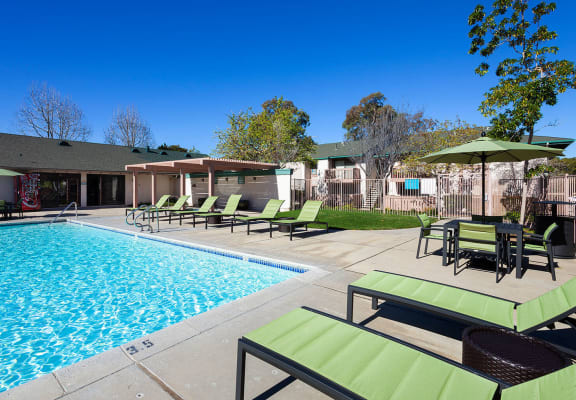 Lounging By The Pool at Knollwood Meadows Apartments, Santa Maria, CA, 93455
