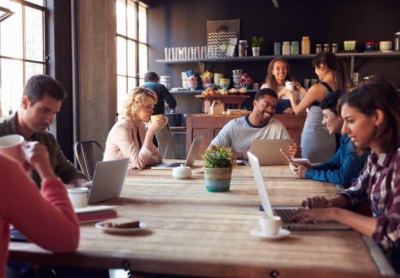Riverside, CA Boulder Creek Apartments Group of People Sitting in Coffee Shop