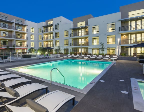 Pool with Lounge Chairs  l Revere Apartments in Campbell, CA