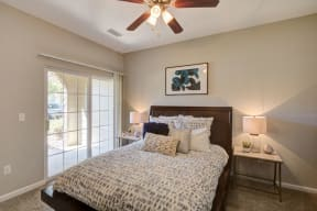 Bedroom with large sliding door in apartment unit in fort collins co