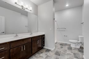 Spacious Bathroom Featuring A Dual Vanity