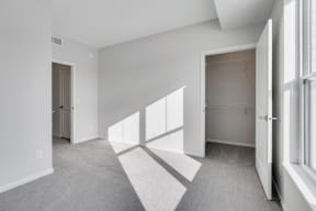 Bedroom Featuring  Lots Of Natural Light & Attached Walk-In Closet