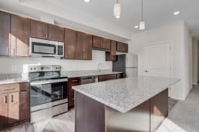 Kitchen Featuring Granite Countertops & Stainless Steel Appliances