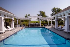 Outdoor Swimming Pool and Expansive Sundeck Overlooking the Field