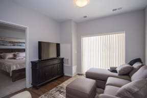 Living Rom with Wood Style Flooring and Sliding Glass Patio Door
