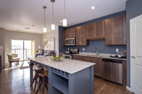 Spacious Kitchen Island with Granite Countertop and Built-In Shelves and Wine Rack