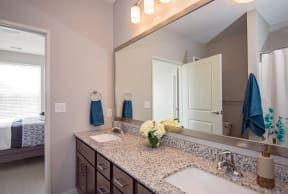 Spacious Bathroom Leading to an Attached Bedroom