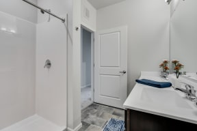 Bathroom With Walk-In Shower With Tile Flooring