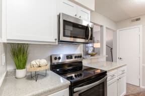 Kitchen with Stainless Steel Microwave and Oven