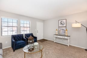 Plush Carpeting in the Living Room with Two Large Windows