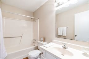 Classic Bathroom with White Vanity and Almond Color Countertop