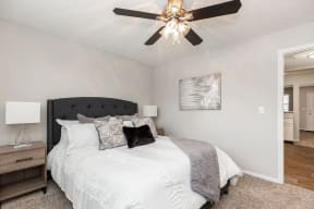 Bedroom with Plush Carpet and Ceiling Fan and Light