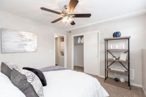 Bedroom with Sliding Closet Doors and Ceiling Fan with Light