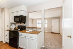 Classic Kitchen with White Cabinets and Black Appliances