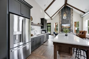 Clubhouse Kitchen with Large Kitchen Island and Stainless Steel Appliances