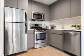 Upgraded kitchens with gray cabinets and stainless steel appliances